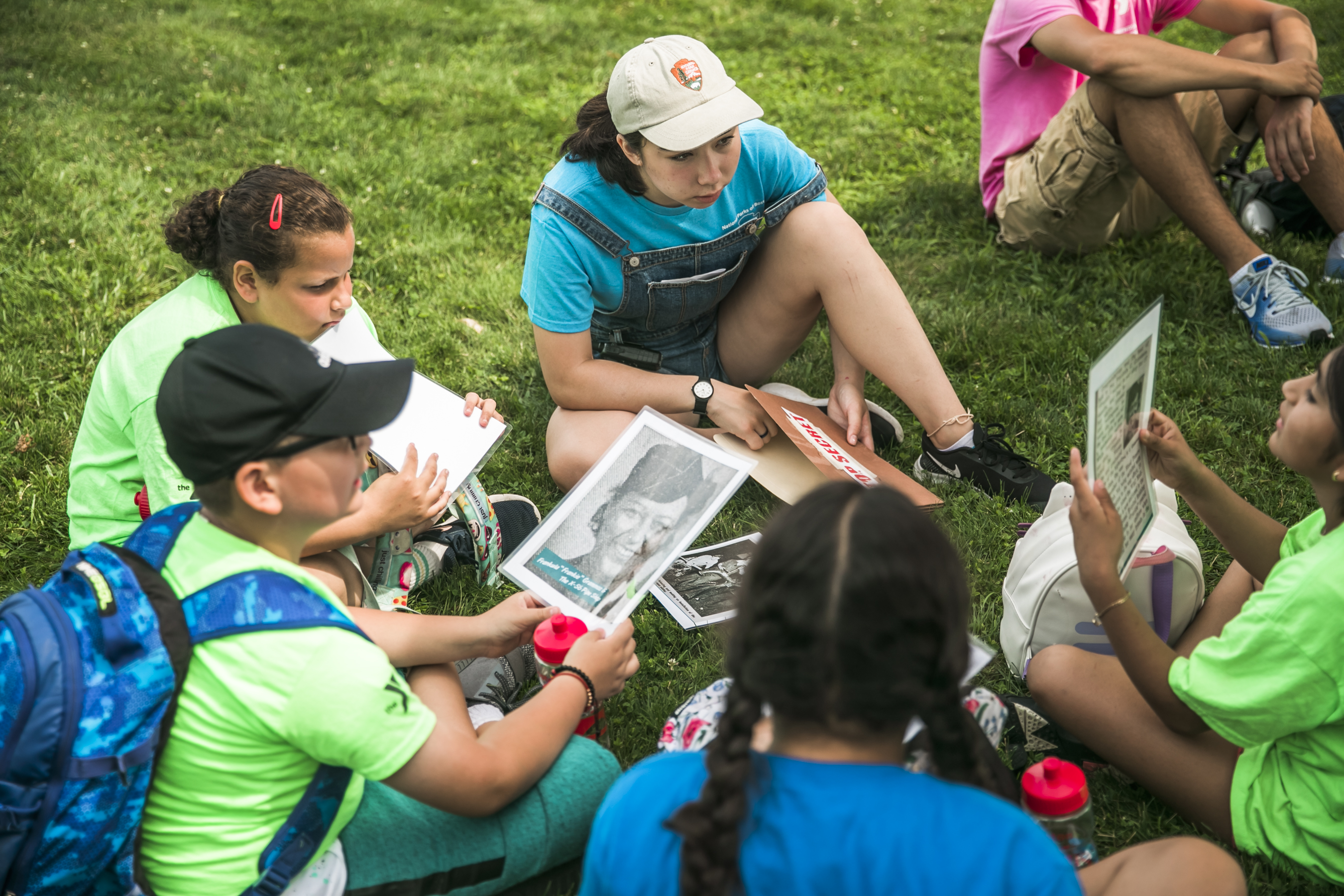 Photo of a 2019 Hill to Harbor YCC facilitating a small-group conversation with campers at the Charlestown Navy Yard