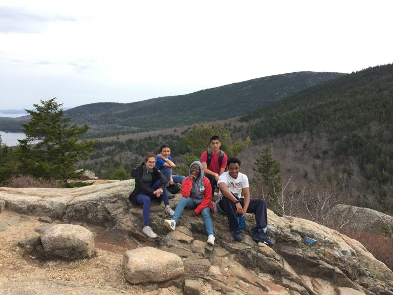Group photo of Spring 2018 PLACE Fellows on a rocky outcrop at Acadia National Park
