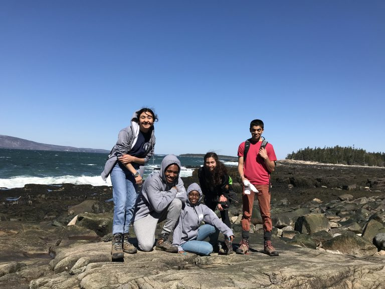 Group photo of Spring 2018 PLACE Fellows at the rocky shore at Acadia National Park