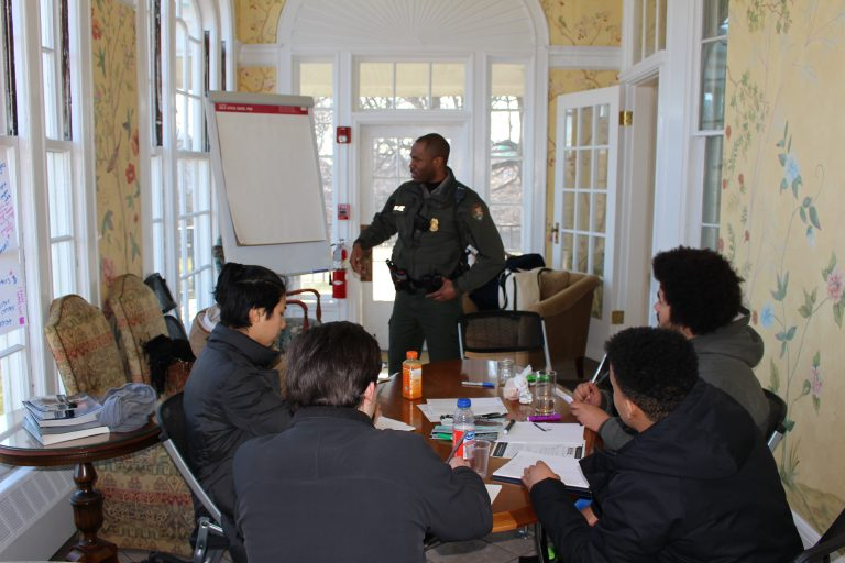 Photo of Fall 2017 PLACE Fellows in conversation with Law Enforcement Ranger Mark
