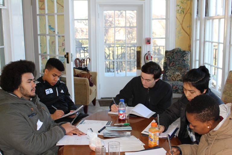 Photo of Fall 2017 PLACE Fellows writing end-of-day reflections