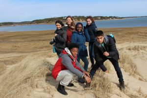 Spring 2018 PLACE Fellows and a program lead on dunes at the Cape Cod National Seashore