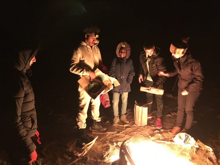 Photo of Spring 2018 PLACE Fellows around a bonfire at the Cape Cod National Seashore