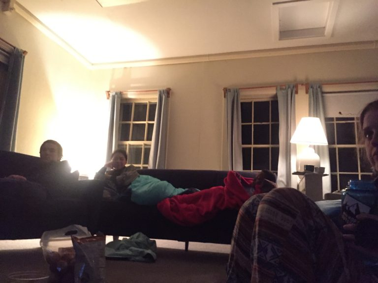 Photo of some Fall 2017 PLACE Fellows enjoying a cozy night in at the rainy Cape Cod