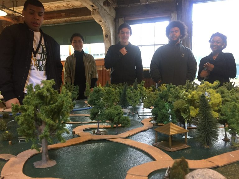 Photo of Fall 2017 PLACE Fellows gathered around a model of an Olmsted park