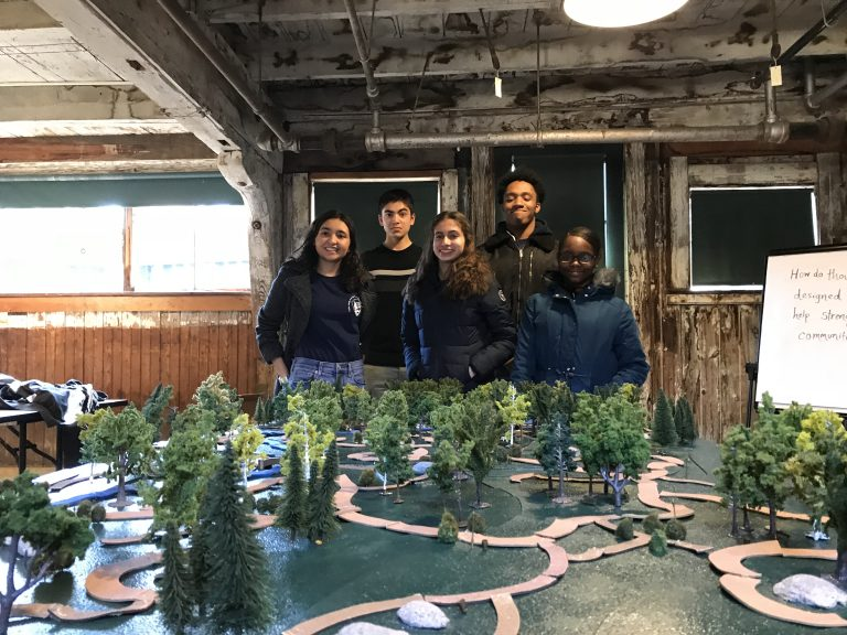 Group photo of Spring 2018 PLACE Fellows at a 3D model of an Olmsted park