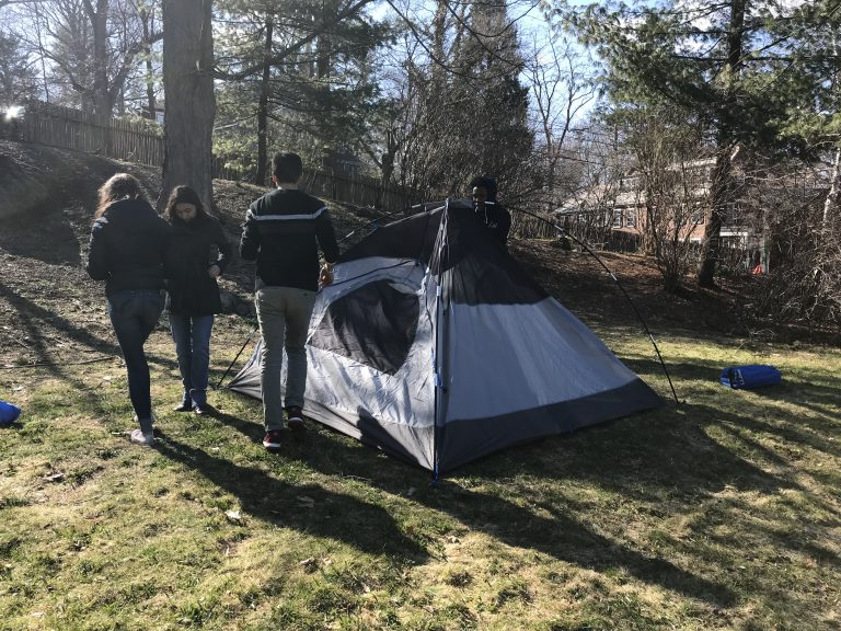 Photo of Spring 2018 PLACE Fellows building a tent