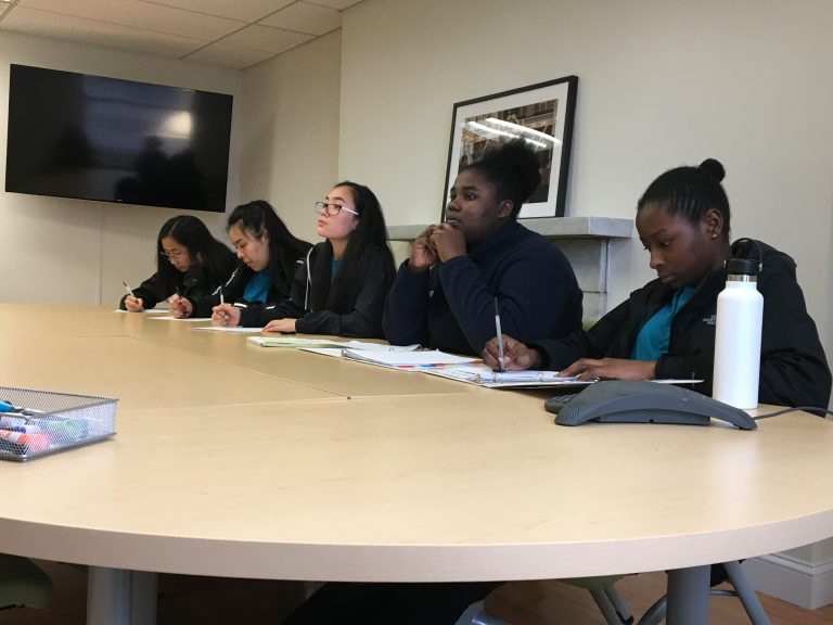 Spring 2019 PLACE Fellows taking notes at National Parks of Boston headquarters