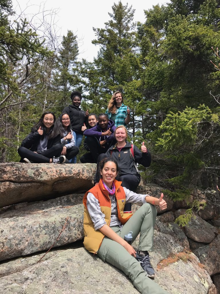Spring 2019 PLACE Fellows and Leads giving a thumbs-up to the camera in Acadia