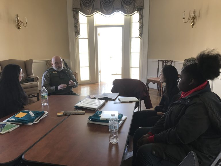 Photo of 2019 PLACE Fellows in conversation with a Ranger at the Charlestown Navy Yard