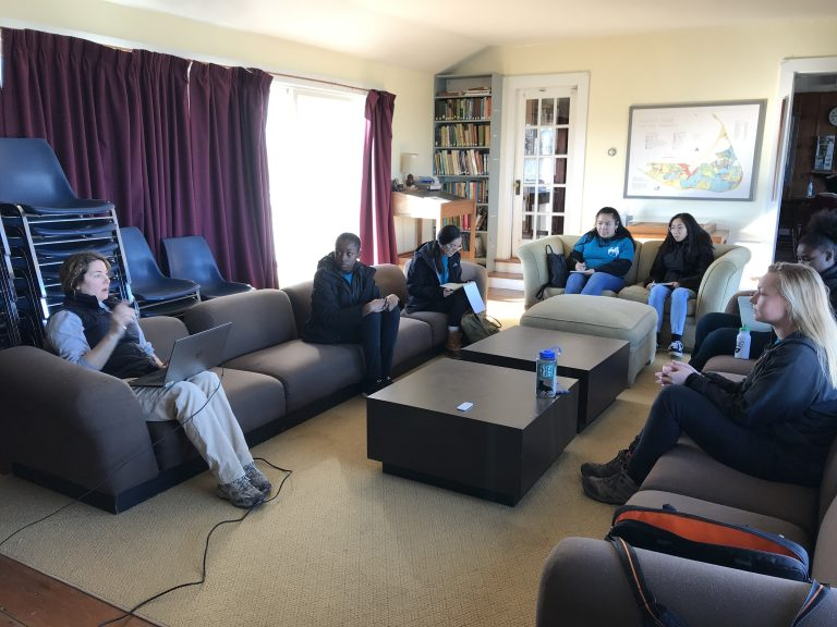 Spring 2019 PLACE Fellows in conversation with a scientist at UMass Boston Nantucket Field Station
