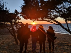 Spring 2019 PLACE Fellows in front of a sunset at Nantucket
