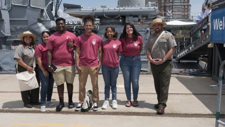 Image of 2019 HdB Cohort (and LHIP Intern Alexandra Santiago) with Rangers Veronica and Kevin at the Charlestown Navy Yard