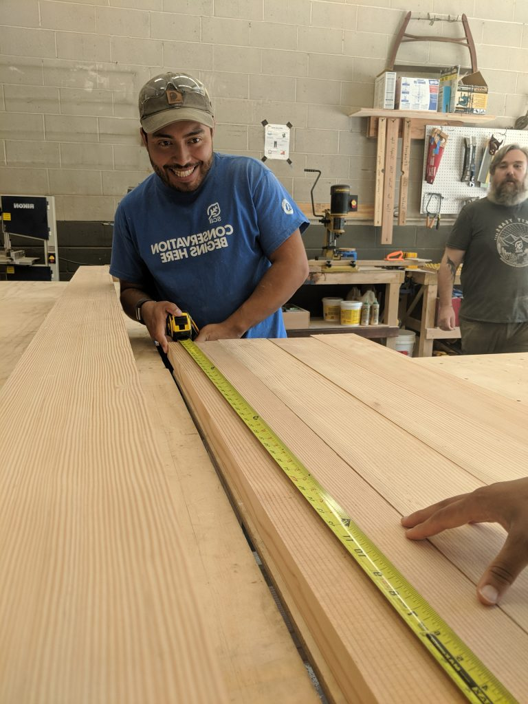 Historic Preservation Fellows measure planks of wood