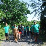 A Year 2 Green Ambassador crew walk beneath trees on a Boston Harbor island.