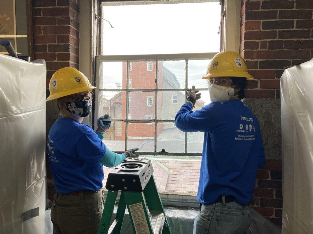 Two HPC members replacing windows