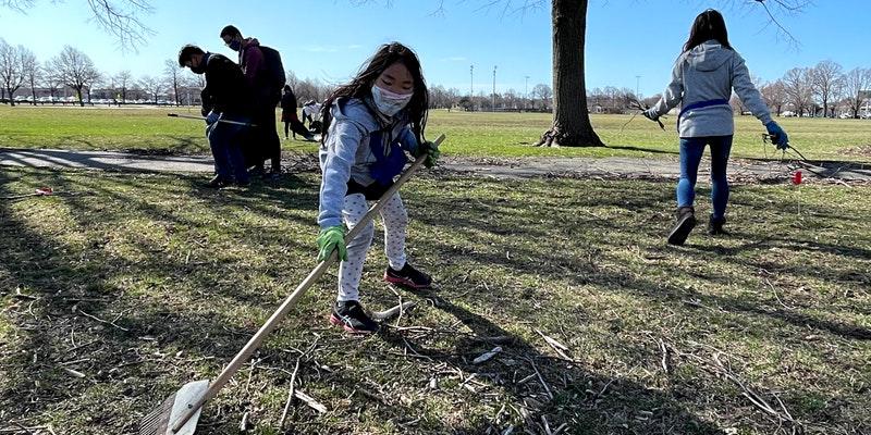 girl raking at Moakley Park