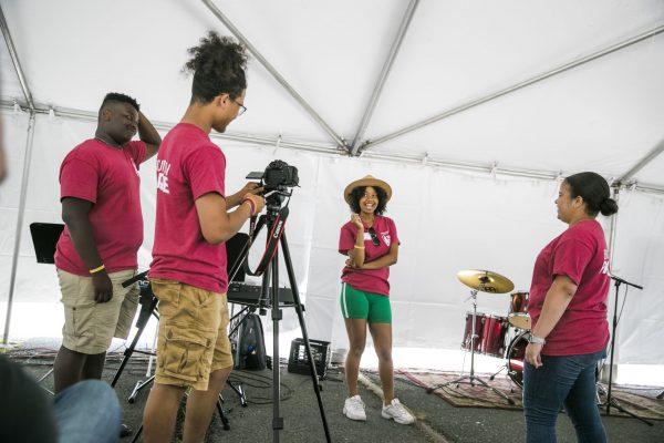 The 2019 Historias de Boston team pretend to interview a member on camera
