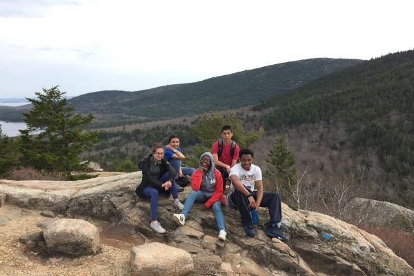 Spring 2018 PLACE Fellows on a rocky outcrop at Acadia National Park