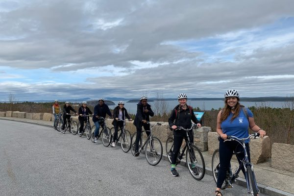 Spring 2019 PLACE Fellows and Leads on bicycles in a line