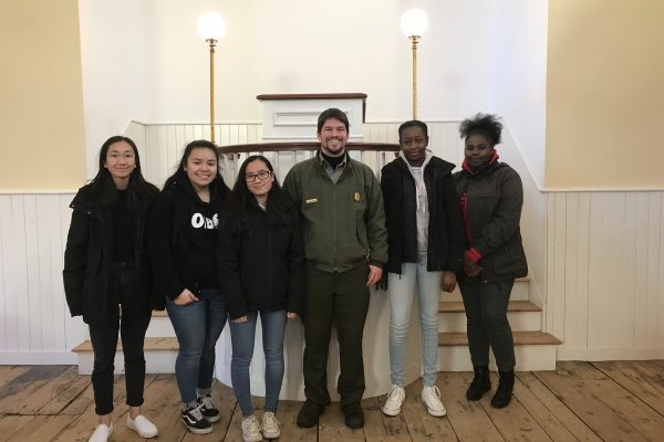 Photo of 2019 PLACE Fellows with a NPS Ranger at the African Meeting House