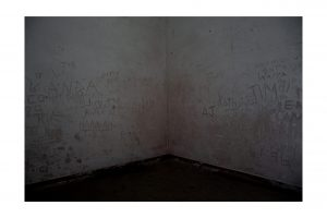 dark corner with writing on walls on georges island