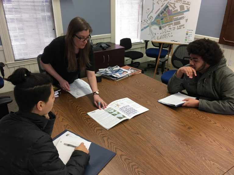 Photo of two Fall 2017 PLACE Fellows listening to the Urban Planner at Lowell National Historic Site