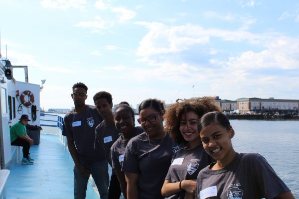 Image of 2018 HdB cohort on a boat in the Boston Harbor
